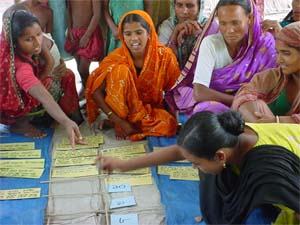 Women participating in a farmer field school organised by CARE in Bangladesh.